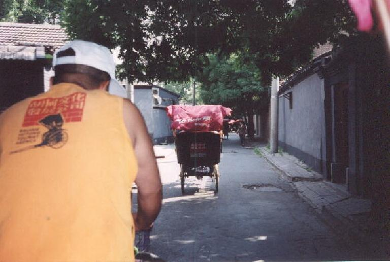 Going through narrow alleys in the rickshaw.  We survived!