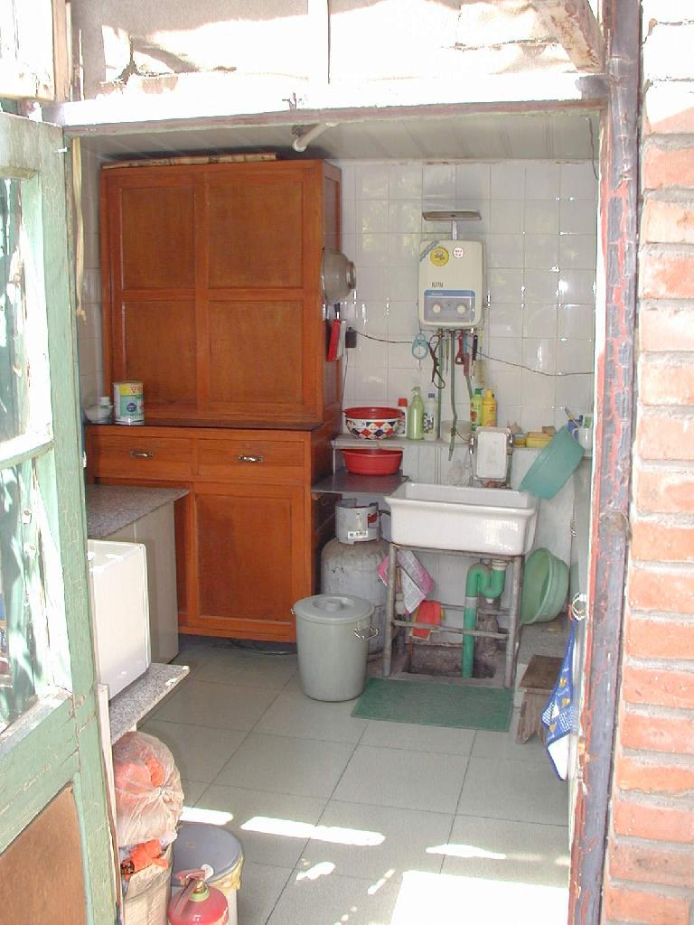 This is Mr. Wu's kitchen.  He has a microwave and other modern appliances. Photo: John Taylor.