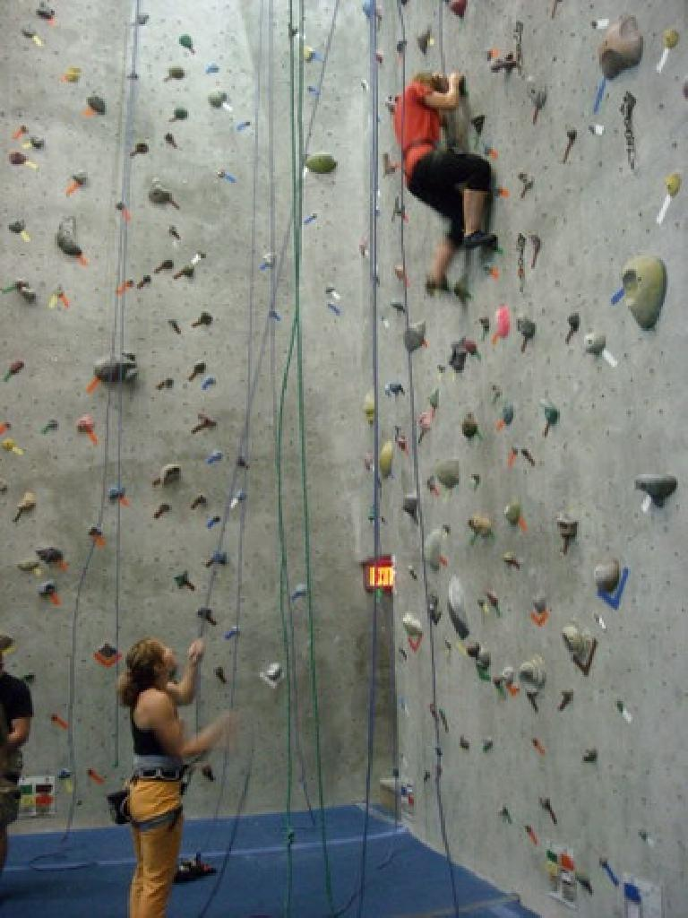Erin on the wall with Tanya belaying below.