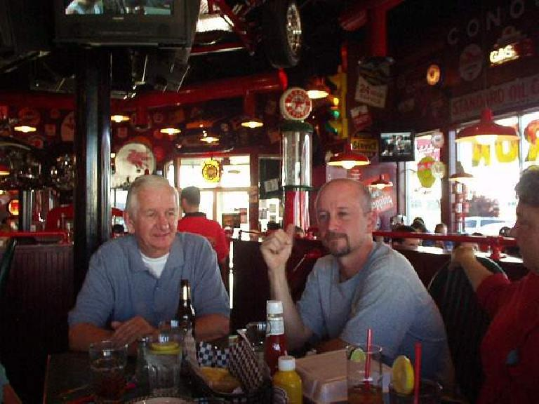 "Gramps and Tom awaiting some of the excellent food to come.  Some of dishes were named ""Intake Manifold Meatloaf,"" ""Chopped Top Sirloin,"" ""Rumble Seat Ribs,"" and the big-block ""Chrysler New Yorker.""  (June 28, 2003)"