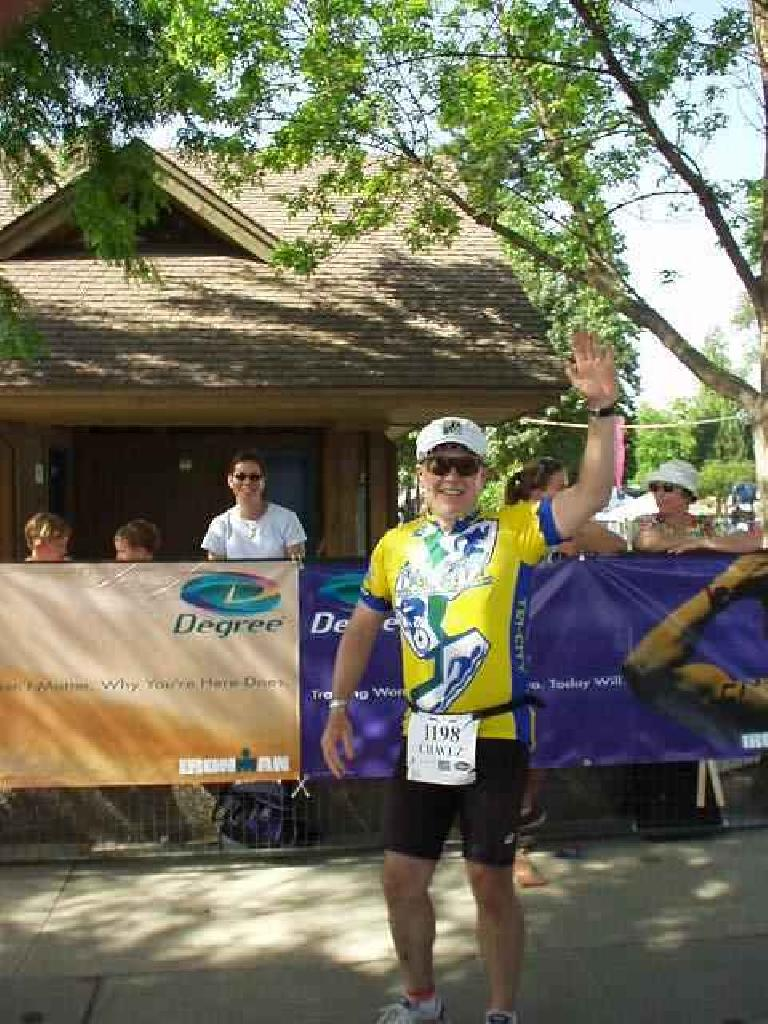 [Run leg] Here's Phil shortly after his bike-to-run transition. (June 29, 2003)