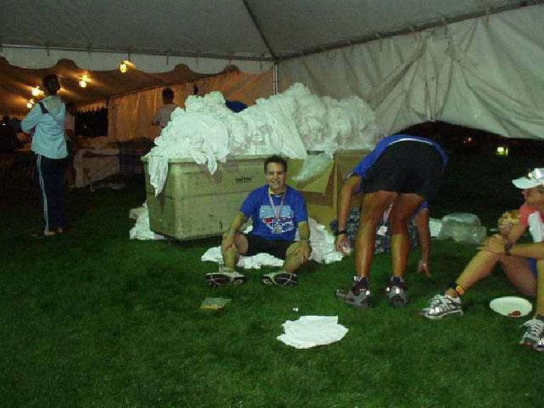 Ironman Phil did it too!  Here he is, sitting on some towels, awaiting a massage.  What a great event! (June 29, 2003)