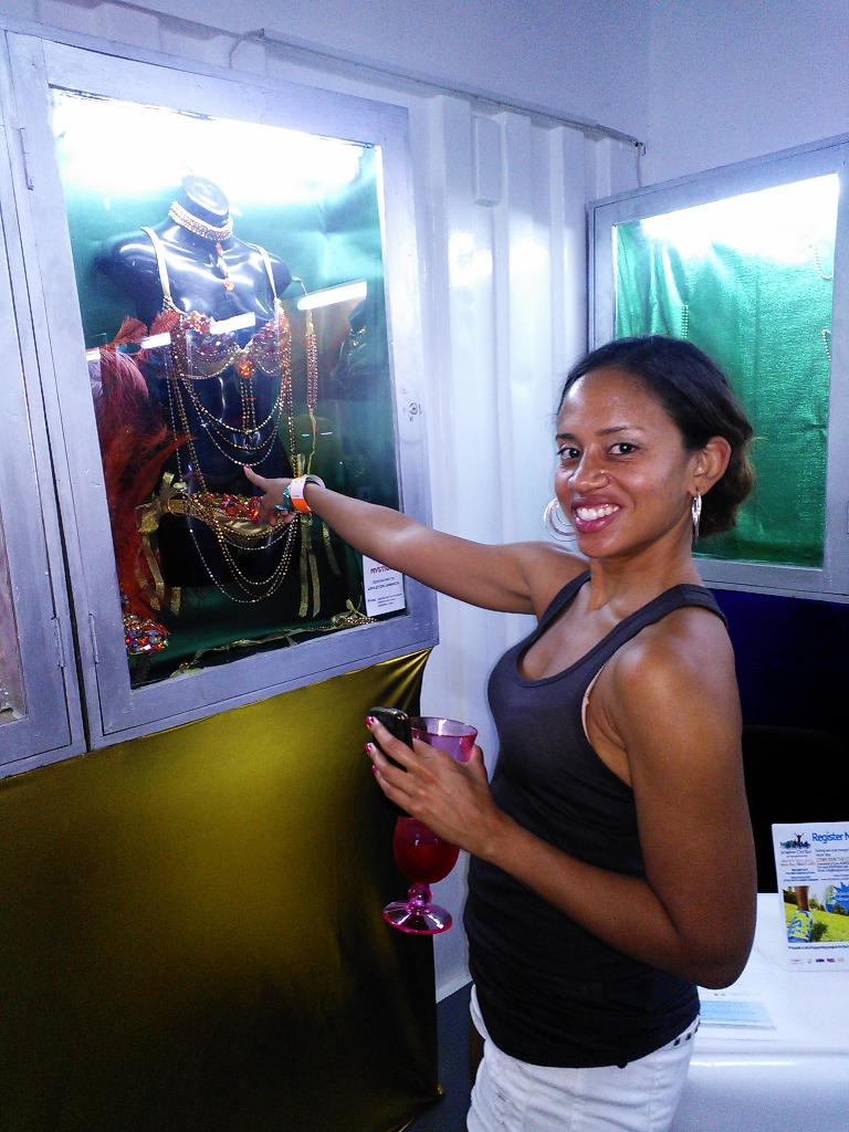 Leanne pointing to the outfit she liked best displayed at the Jamaican party. (February 15, 2013)