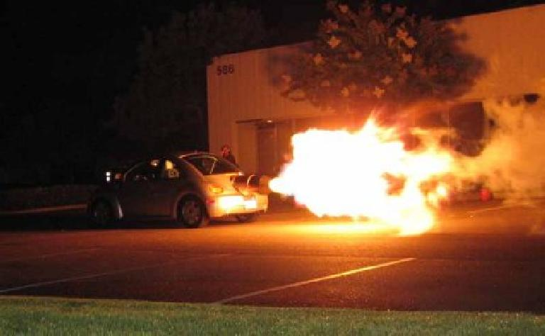 flames shooting out of jet-powered New Beetle at night