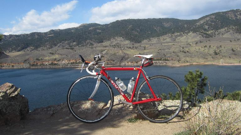 My red Cannondale 3.0 in front of the Horsetooth Reservoir and Horsetooth Rock.