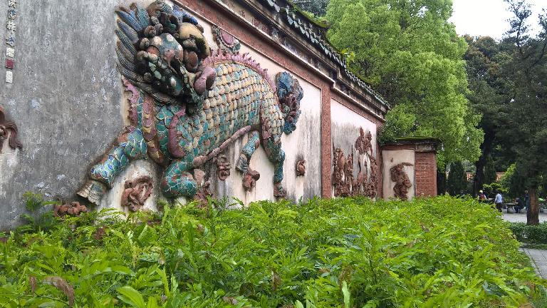 Dragon (lion?) wall carving at the Kaiyuan Temple in Quanzhou, China.