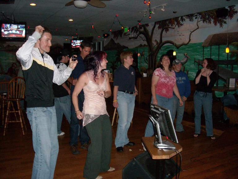 The others dancing to Felix's singing.