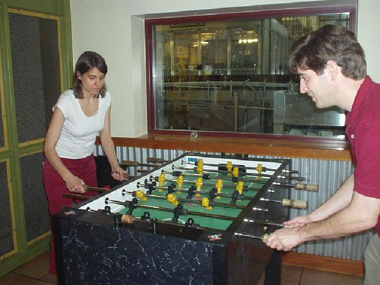 Kat and Guy engaged in a spirited game of foosball at the brewery.