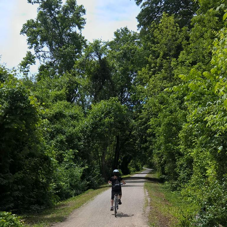 Maureen riding southwest on the Katy Trail a few miles from St. Charles.