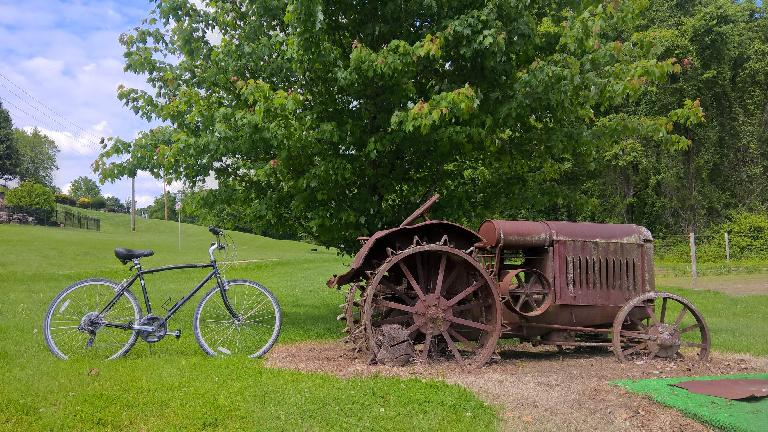 Rental bike and old tractor.