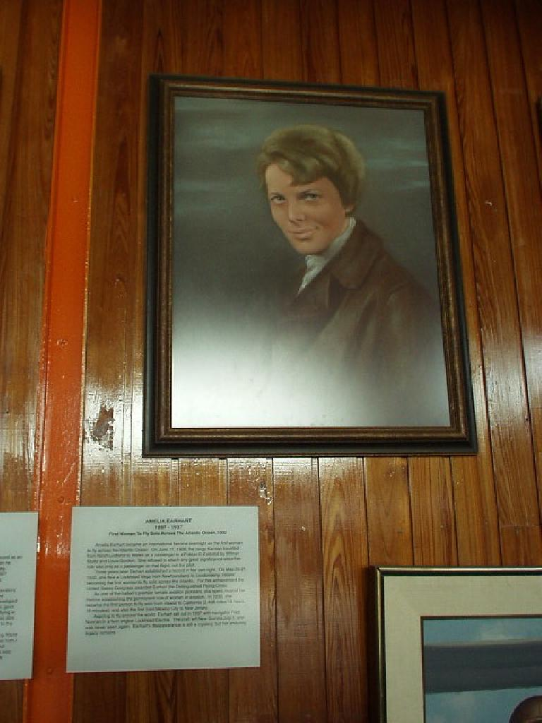 """In the same room as the airplane and the glider were portraits of people who achieved """"firsts"""" in aviation.  This is Amelia Earhart, the first woman to fly solo across the Atlantic Ocean."""