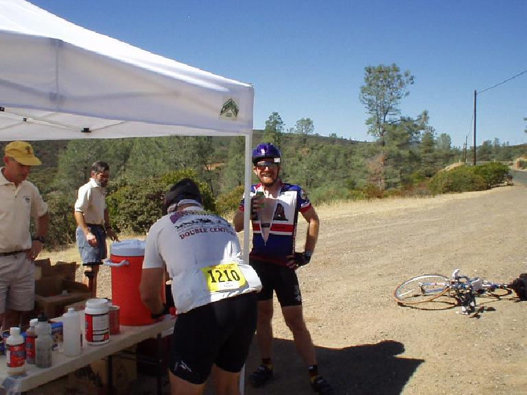 "Mile 94, 12:22pm: My friend Adam Paulaul"", also from Fremont and a California Triple Crown winner, at the water stop."
