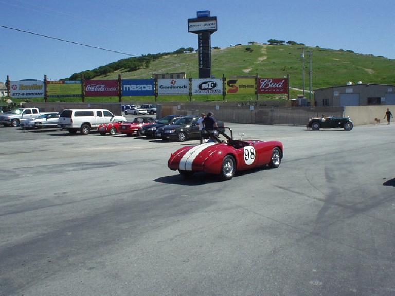 Getting in line was this gorgeous red MGA race car with white racing stripes.
