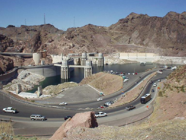 Cars navigate a tight turn around Hoover Dam.