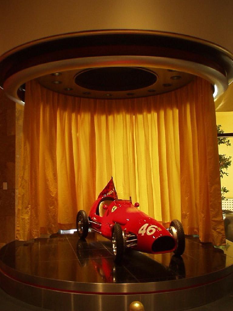 A scaled-down Ferrari race car.