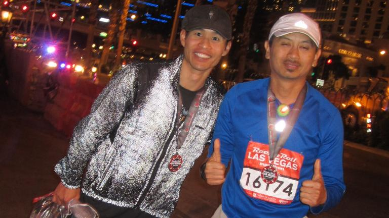Felix Wong with Bandy after completion of Bandy's first marathon.