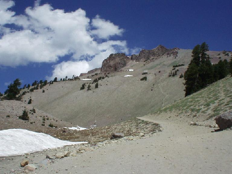 """Lassen Peak is the highest peak in Shasta County, at ~10500'.  Towards the right of the photo you can see the """"healing scar"""" which was actually a steep firetrail blazed by shortcutting hikers (now strictly prohibited)."""