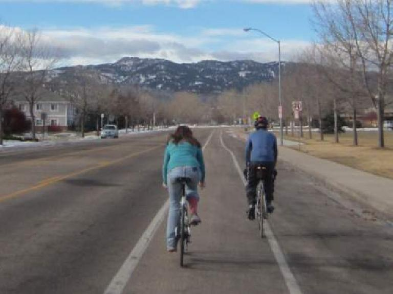 Kelly and Dave riding towards Horsetooth Rock.
