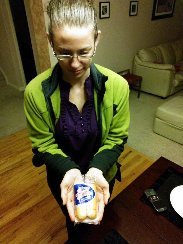 Colleen in anticipation of trying a Twinkie for the first time in her life, five days before the expiration date on the package.