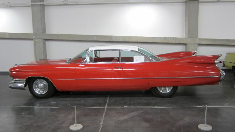 Cadillac Coupe with massive tailfins from the 1950s (a Henry Earl design).