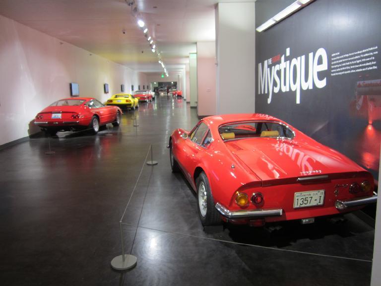 "The Ferrari hallway.  On the left is a nice red 1971 Ferrari 365 GTB/4 ""Daytona."""