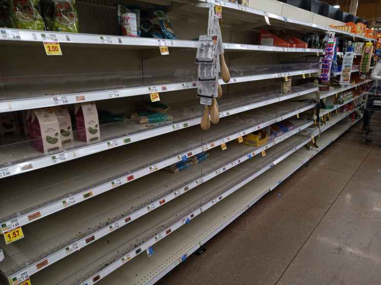 A day after the country's State of Emergency declaration for the coronavirus, shelves for staples like canned vegetables and beans at King Soopers were empty.