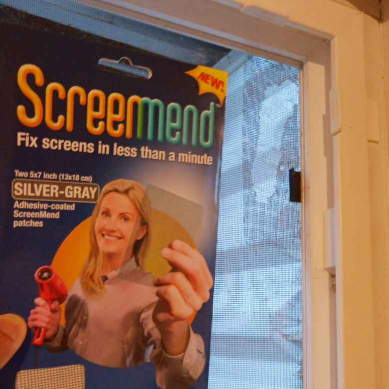 Using ScreenMend to repair a hole in a window screen.