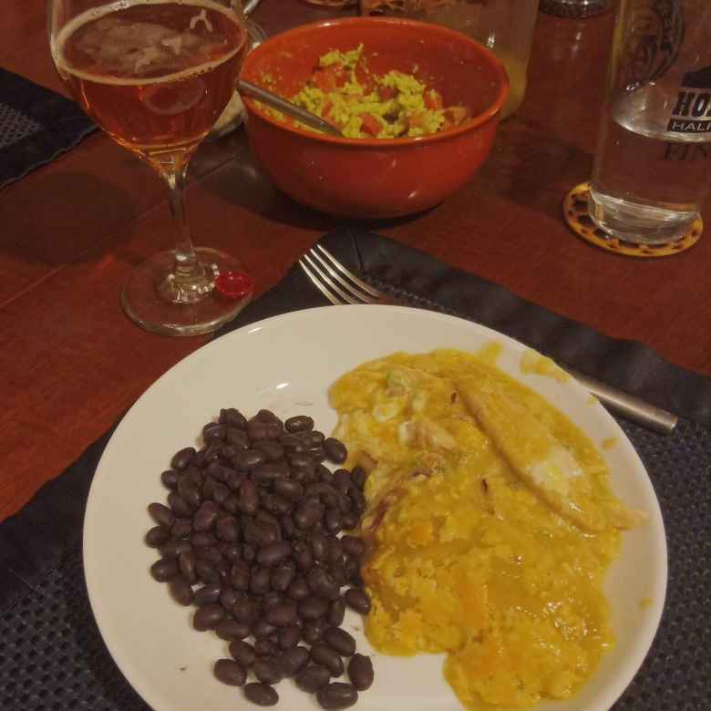 Black beans, chicken enchiladas, guacamole, and beer for dinner.
