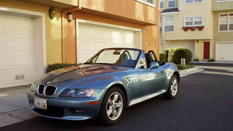 """Lina in what I dubbed, """"Sports Car Alley,"""" as it seems like half of my neighbors have sports cars! (February 1, 2003)"""
