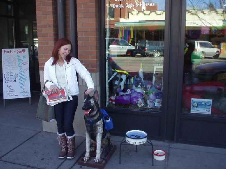 Lisa makes friends with a dog after we had lunch in Boulder.