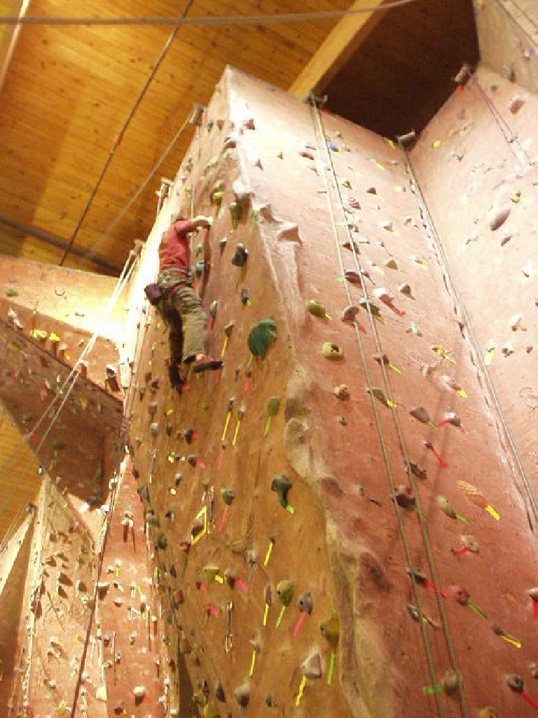 On Sunday, we joined up with Jeremy, Zach, and Rhea for a fun evening of climbing at the Gym of the Rockies.  This is Jeremy on the wall... (February 26, 2006)