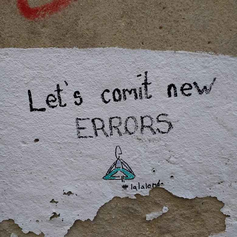 """Let's comit [sic] new errors""---as seen on a wall in Alfama."