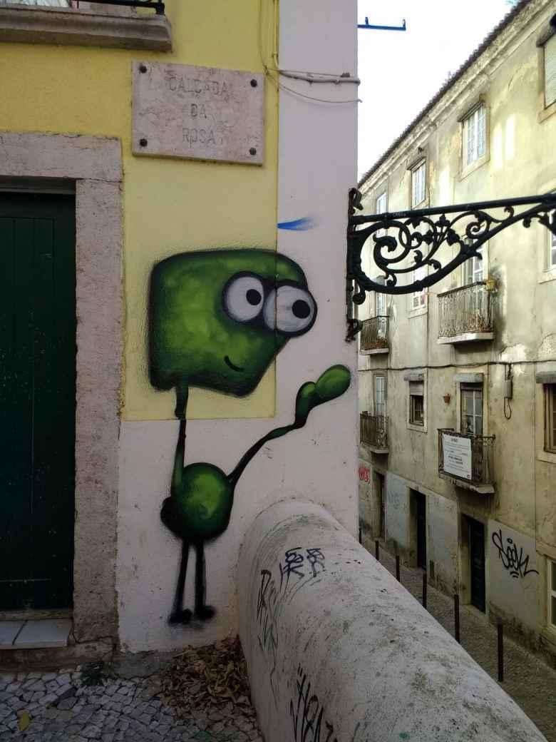 Graffiti of a Martian on Calcada da Rosa in the neighborhood around Castelo de São Jorge.