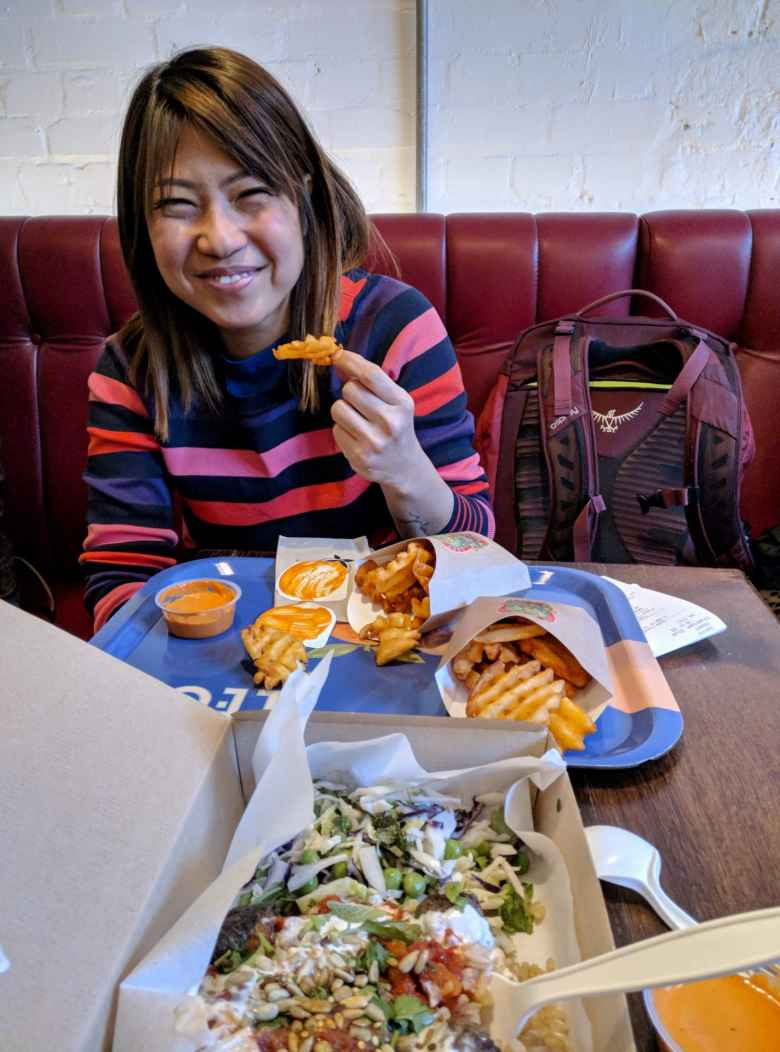 Angie and our food from Leon, which included Sicilian meatballs and fries.
