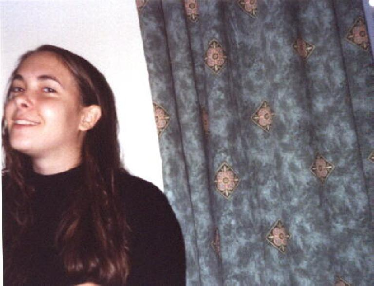 Carolyn in her flat. (September 25, 1999)