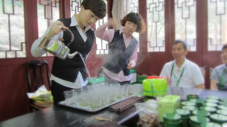 Two ladies touting the benefits of Longjing green tea.