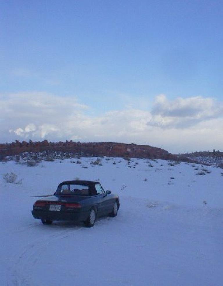The Alfa Romeo in the winter wonderland.