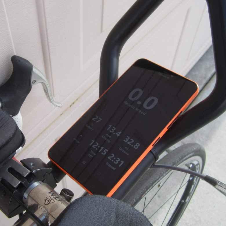 orange Microsoft Lumia 640 XL mounted on bicycle aerobars, Cycle Tracks hide map mode