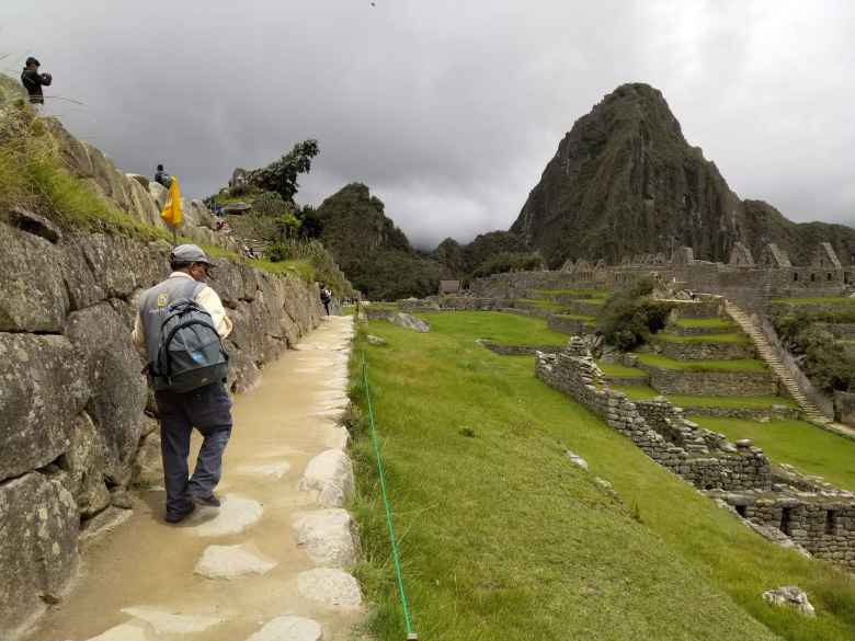 Tourist walking at Machu Picchu.