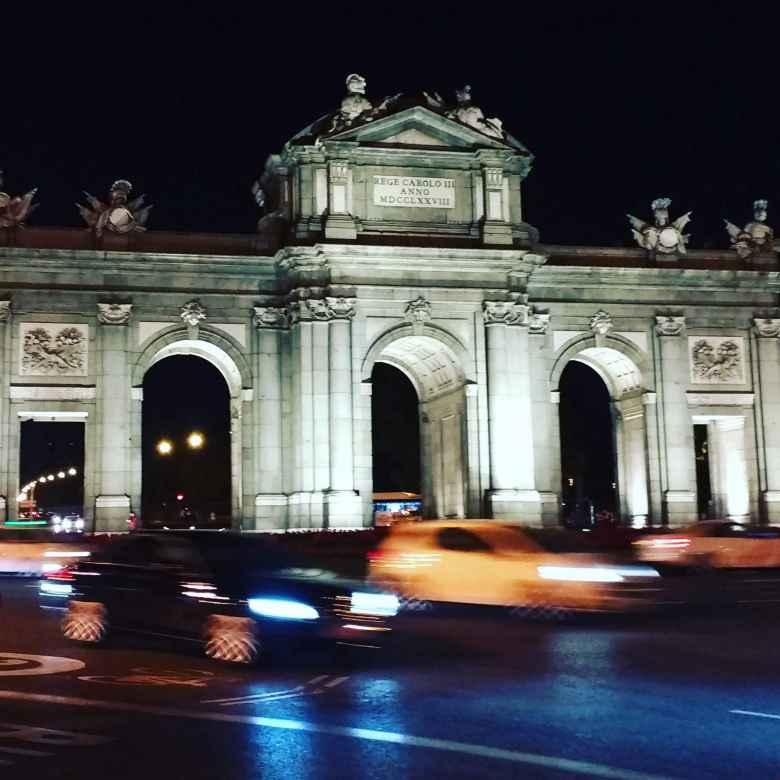 Puerta de Alcalá in Madrid at night.