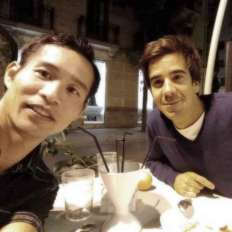 Felix Wong and friend Javier outside Restaurante Álbora in Madrid, Spain.