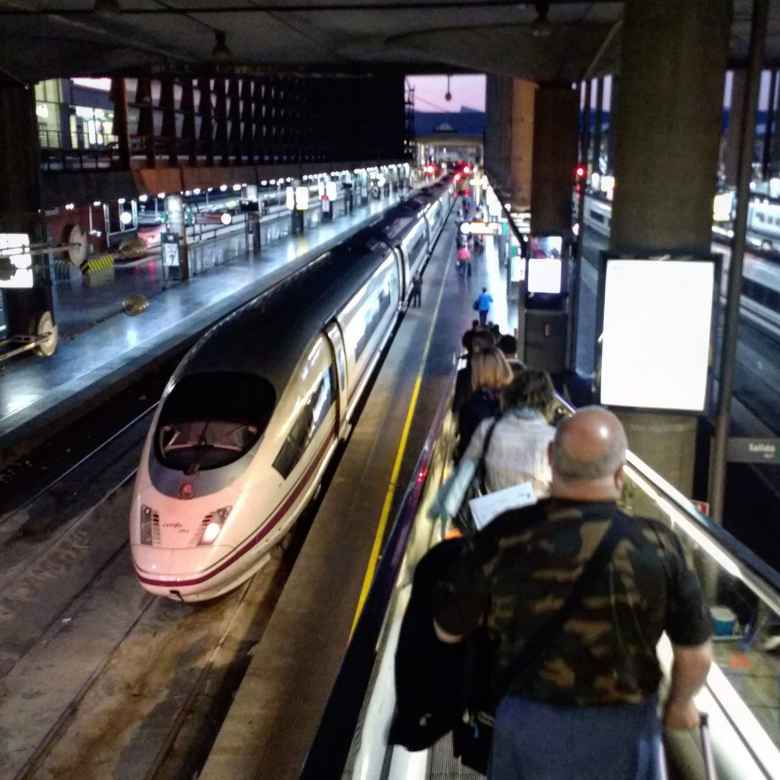 The AVE train from Madrid to Barcelona departing from Madrid's Atocha train station.