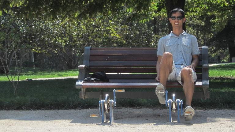 Using one of the pedal contraptions in el Parque del Retiro.