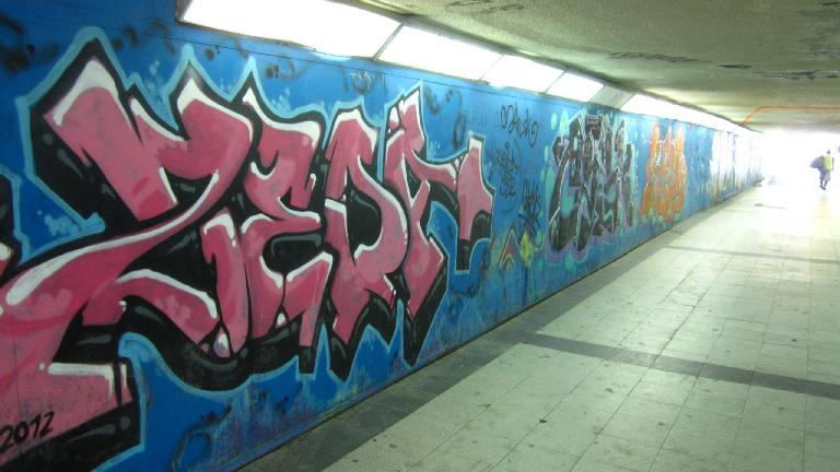 Urban art (graffiti) in an underpass to the metro near el Parque del Retiro.