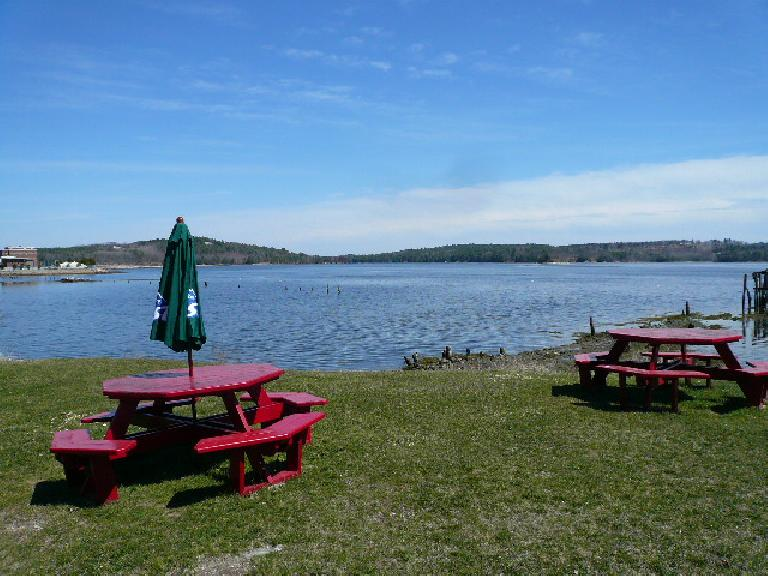 Picnic tables by the Sheepscot River.