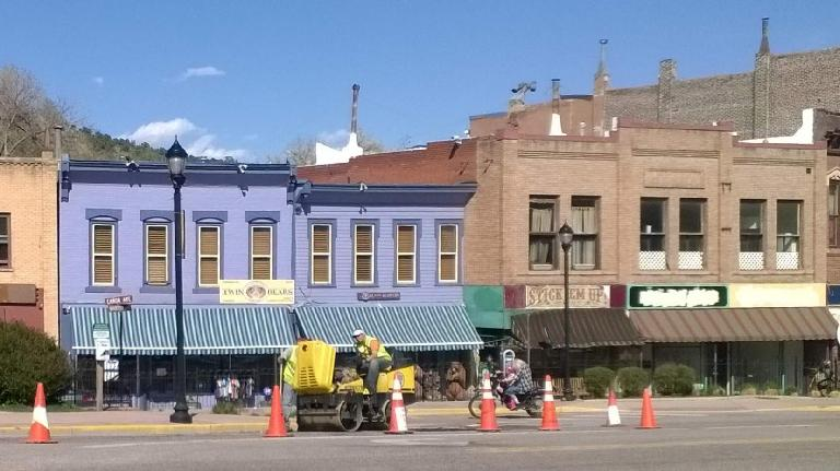 Downtown Manitou Springs, construction, motorcycle with adult and child