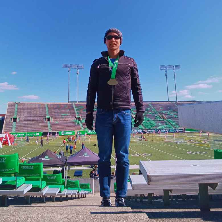 Felix Wong inside the Joan C. Edwards Stadium after finishing the Marshall University Marathon.