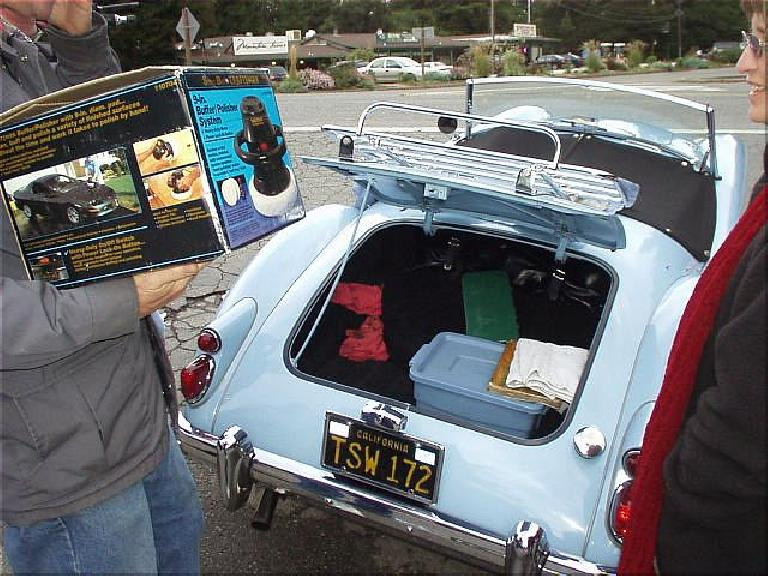 "At this meeting I returned Mike Jacobsen's orbital buffer, which Mike had graciously lent me a couple of months ago.  ""But where am I going to put it?"" Mike asked, since the box was to big for the trunk in his MGA and the passenger seat was needed for his guest..."