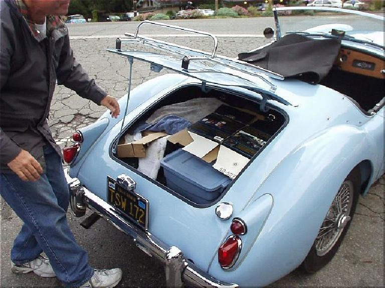 "Problem solved!  Mike took everything out of the box, rearranged things in the trunk, and flattened the box.  It was quite entertaining to watch.  ""And if anyone needs to do a wax and polish along the coast..."""