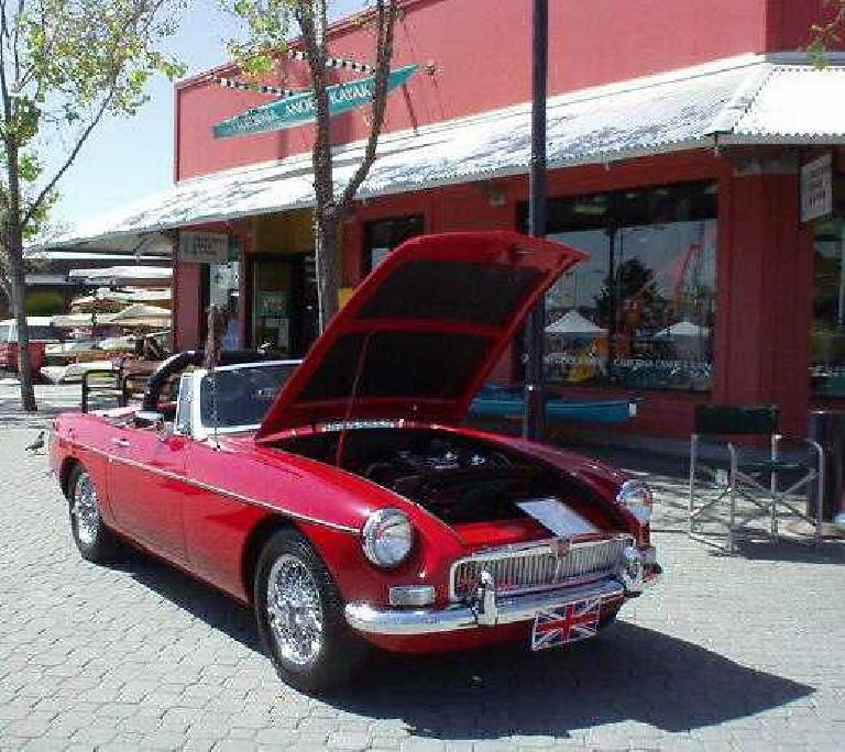 Red MGB in front of California Canoe & Kayak at Jack London Square.
